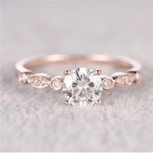 Jewelry - NWOT Rose Gold Faux Diamond Ring sz 5